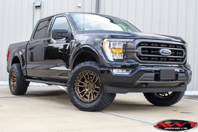 Black 2021 Ford F150 Rough Country level lift bronze 20x10 Fuel Off-road D681 Rebel Wheels Nitto Recon Grappler Tires